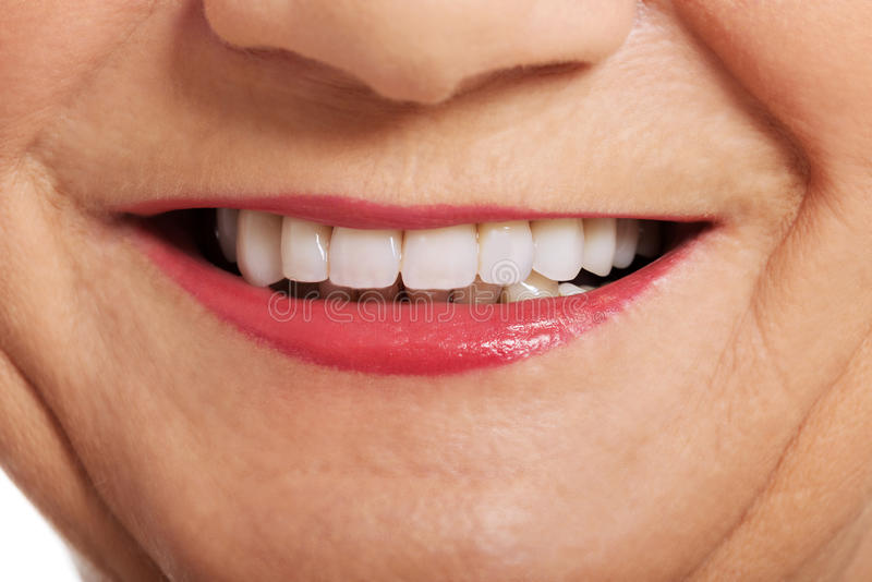 Close up on ol woman's smile, teeth. stock images
