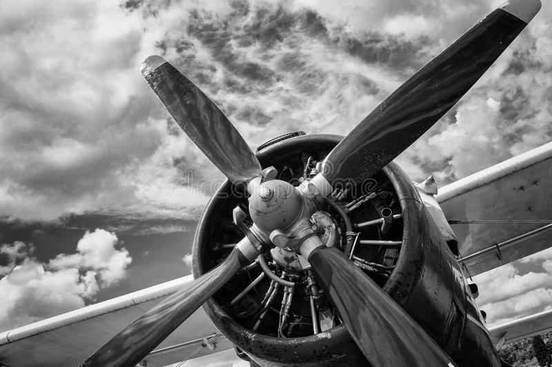 Close up of old airplane in black and white royalty free stock image