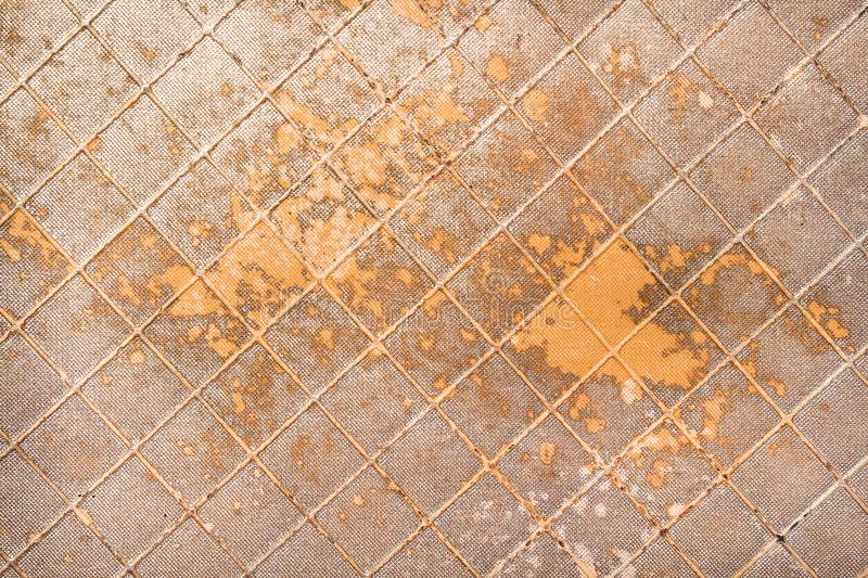 Old artificial gold leather texture for background stock photography