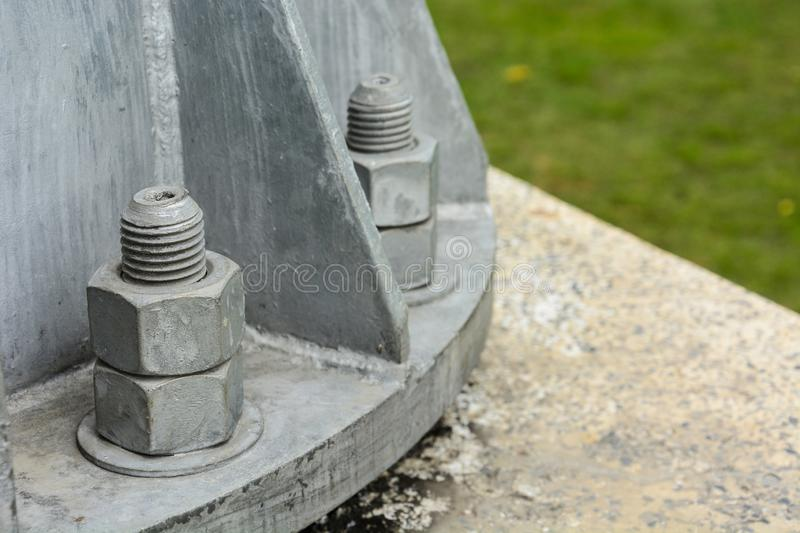 Old bolts and nuts of light pole base stock image