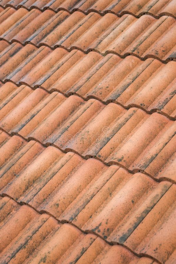Brown clay roof tiles. Close up old brown clay roof tiles royalty free stock image