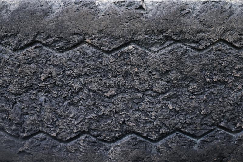 Close up old damaged and worn black tire tread truck. Tire tread problems and solutions for road safety concept. Change time. tran royalty free stock images