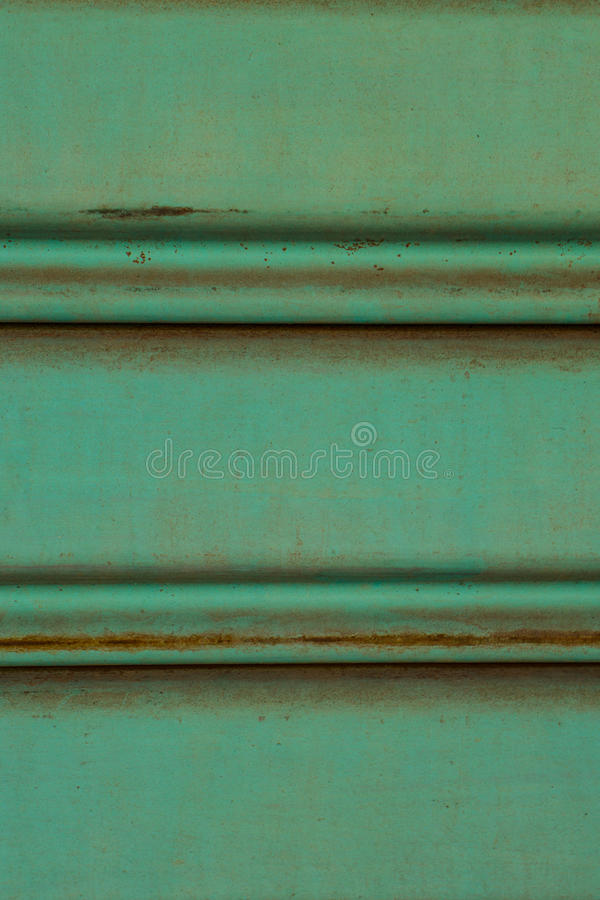 Close up of old and dirty corrugated of mint metal sheet slide d. Oor.photo taken on: March 4th, 2016 royalty free stock image