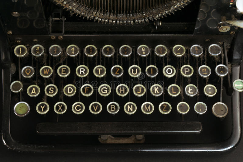 Close-up of an Old and Dusty Typewriter Keyboard. Old, Dusty Typewriter keyboard close-up royalty free stock photography