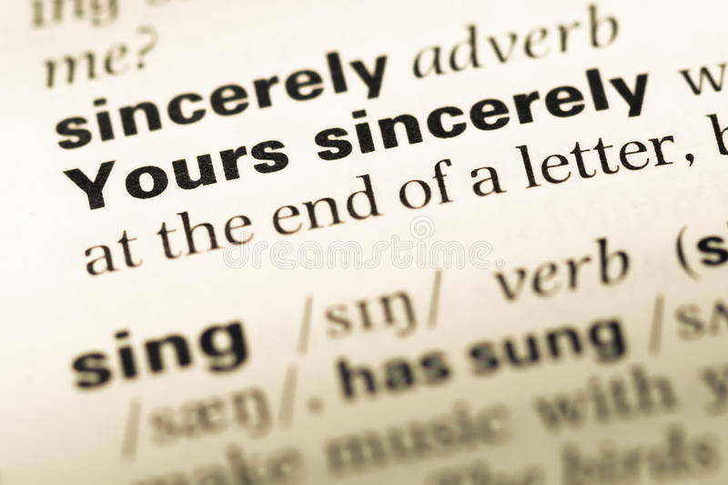 Close up of old English dictionary page with word yours sincerely stock image