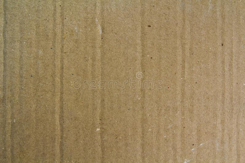 Close up old grainy decorative light brown vintage rough sheet of carton cardboard paper texture or background. royalty free stock photography