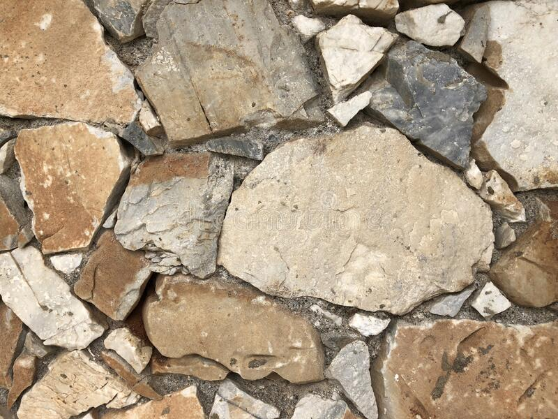 Old gray stone wall for abstract background stock image