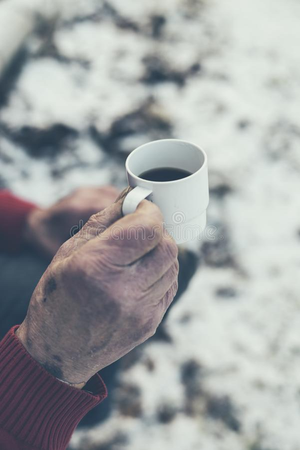 Close up Old Male Hand Holding a Cup of Hot Black Coffee royalty free stock photography