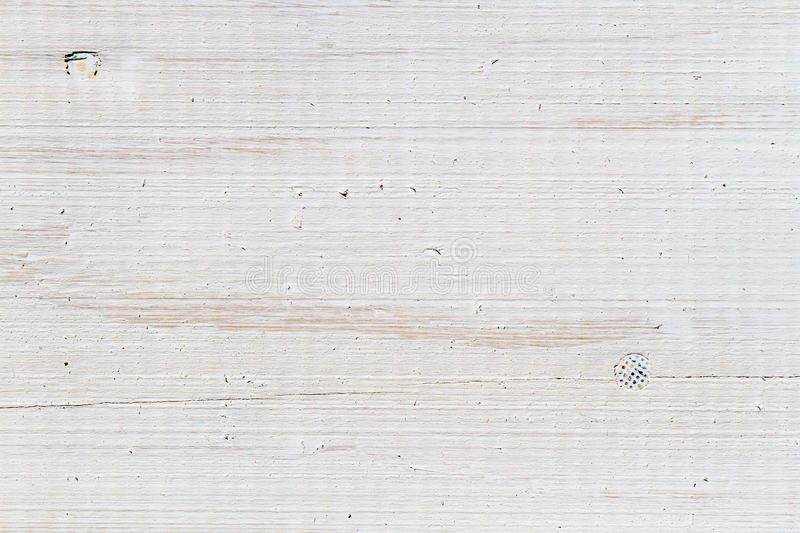 Close-up of the old plank with nails painted royalty free stock photo
