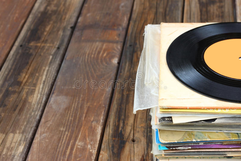 Close up of old record and records stack. Room for text. pic royalty free stock photo