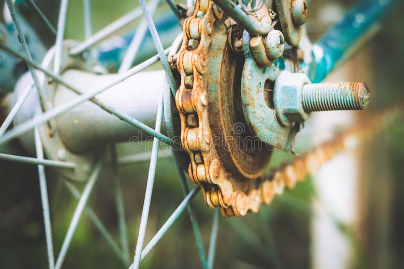 Close up of old rusty chain from the bicycle on background nature ,Bicycle`s detail view of wheel with old chain, sprocket,dirty stock image