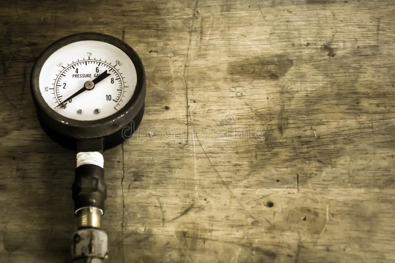 Close up old and rusty pressure gauge on wood background,vintage style. Close up old and rusty pressure gauge on wood background,vintage  style stock image