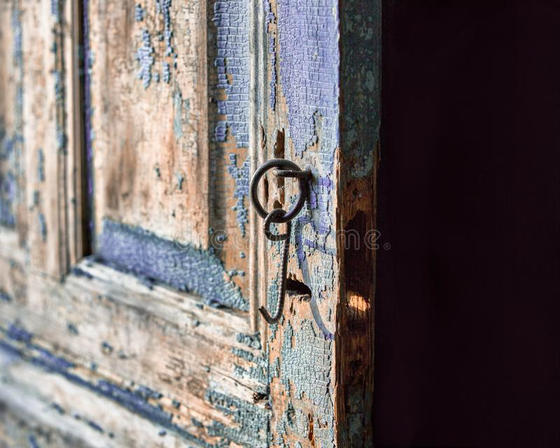 A close-up of the old shabby door stock photography