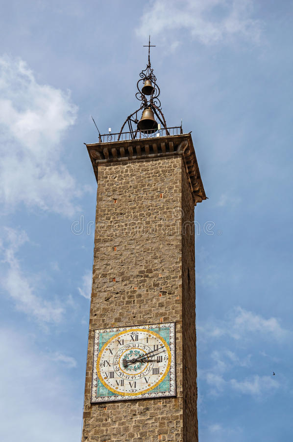 Close-up of old stone campanile with bell an clock in the city center of Viterbo. stock photos