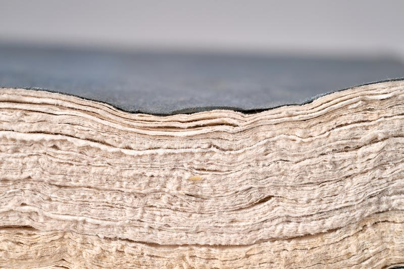 Close up of old textured paper , no waste , recycle paper concept. Pages of the old book stock image