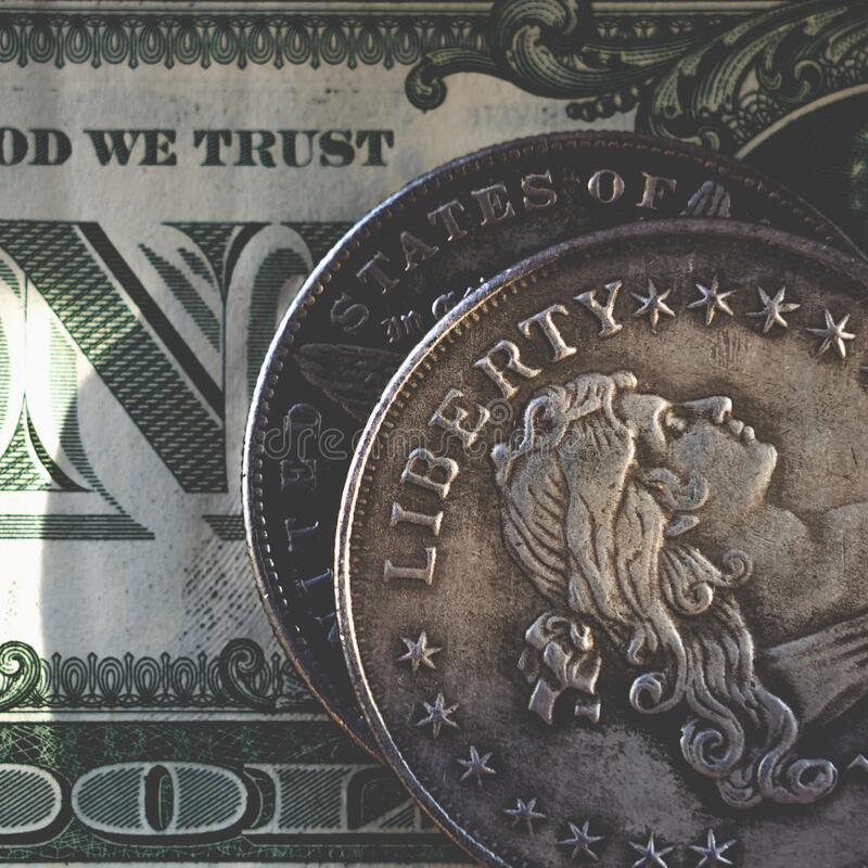 Close up old US coins with inscription: Liberty and one Dollar bill as symbol: America is the land of opportunities and freedom royalty free stock image