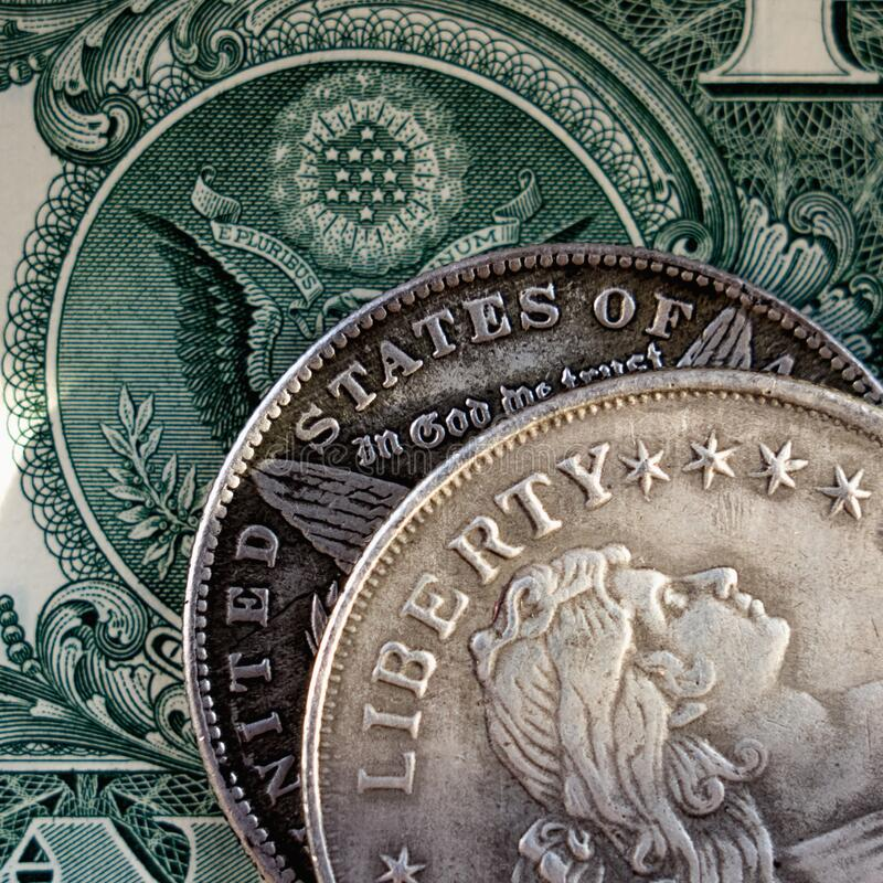 Close up old US coins with inscription: Liberty and one Dollar bill as symbol of success, wealth and business stock images