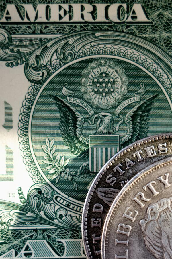 Close up old US coins and one Dollar bill as symbol: America - the land of opportunities and freedom. Selective focus on word royalty free stock images