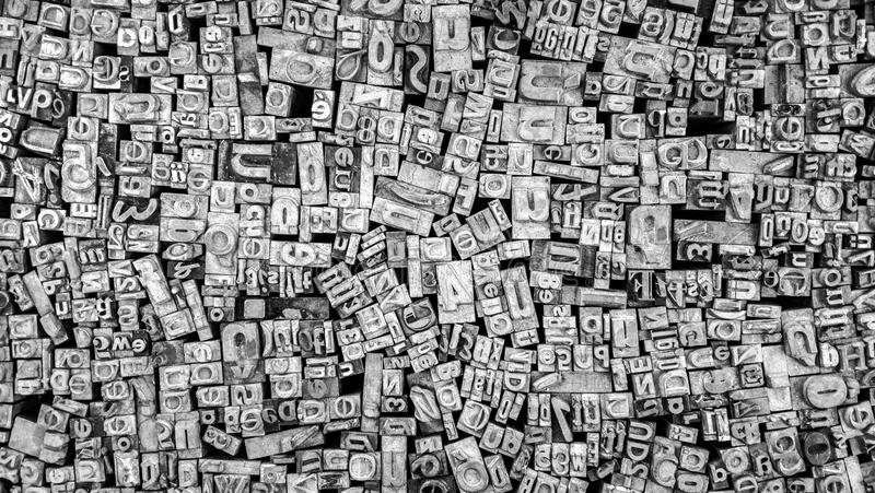 Close Up of Old Used Metal Typeset Letters stock image
