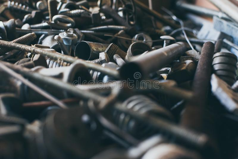 Close-up old used spare part, rust bolts and knots many sizes royalty free stock photos