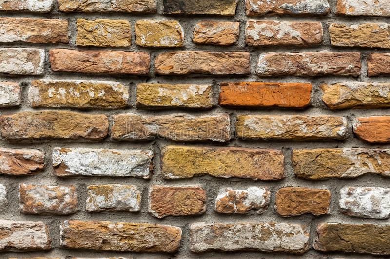 Close-up old vintage brick wall white yellow red tinted stones royalty free stock photography