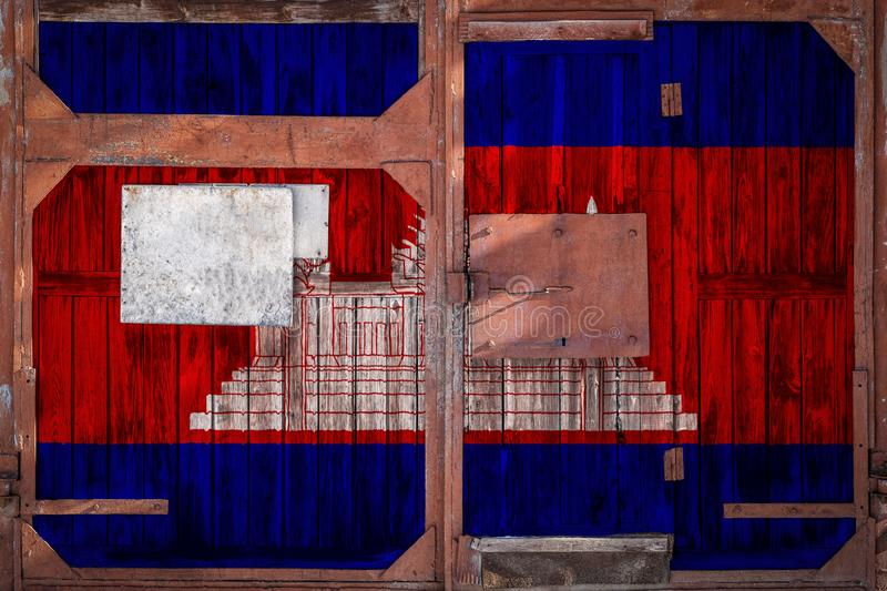 Close-up of old warehouse gate with national flag. Of Ð¡ambodia. The concept of export-import Cambodia, storage of goods and national delivery of goods. Flag royalty free illustration