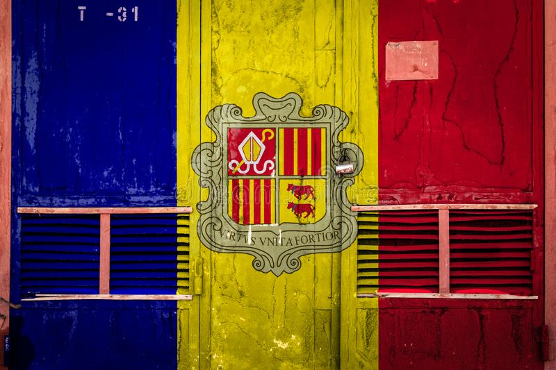 Close-up of old warehouse gate with national flag. Of Andorra. Concept of Andorra export-import, storage of goods and national delivery of goods. Flag in grunge stock illustration