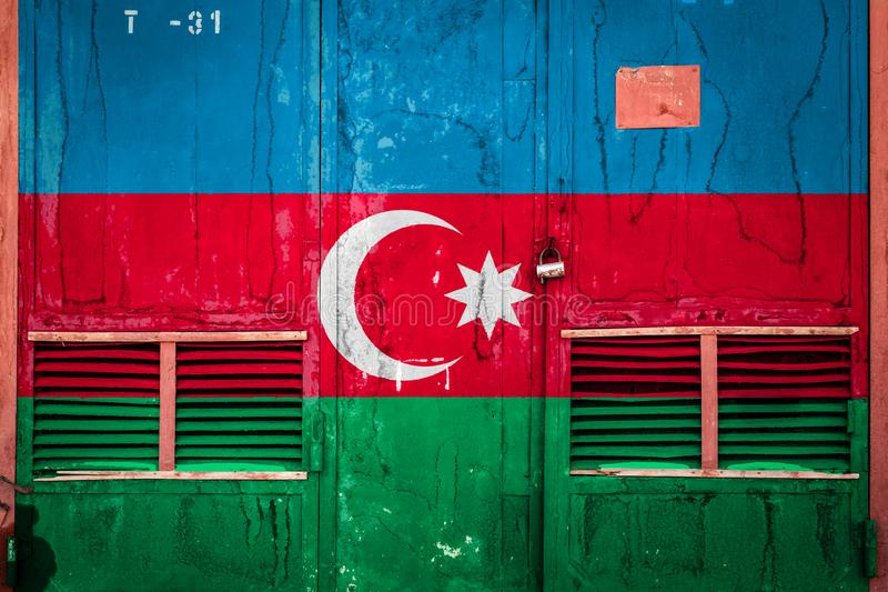 Close-up of old warehouse gate with national flag. Of Azerbaijan. Concept of Azerbaijan export-import, storage of goods and national delivery of goods. Flag in stock illustration