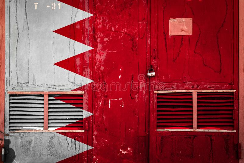 Close-up of old warehouse gate with national flag. Of Bahrain. Concept of Bahrain export-import, storage of goods and national delivery of goods. Flag in grunge stock illustration