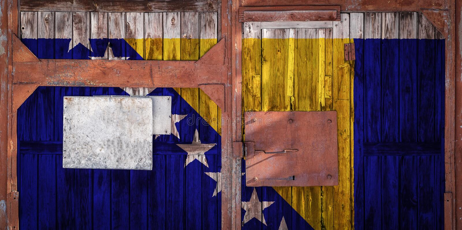 Close-up of old warehouse gate with national flag. Of Bosnia herzegovina. The concept of export-import of Bosnia Herzegovina, storage of goods and national stock illustration