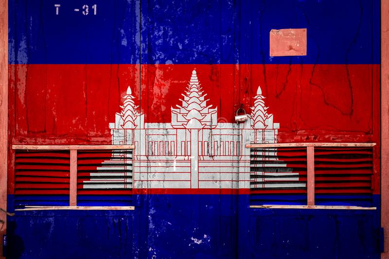 Close-up of old warehouse gate with national flag. Of Cambodia. Concept of Cambodia export-import, storage of goods and national delivery of goods. Flag in stock illustration