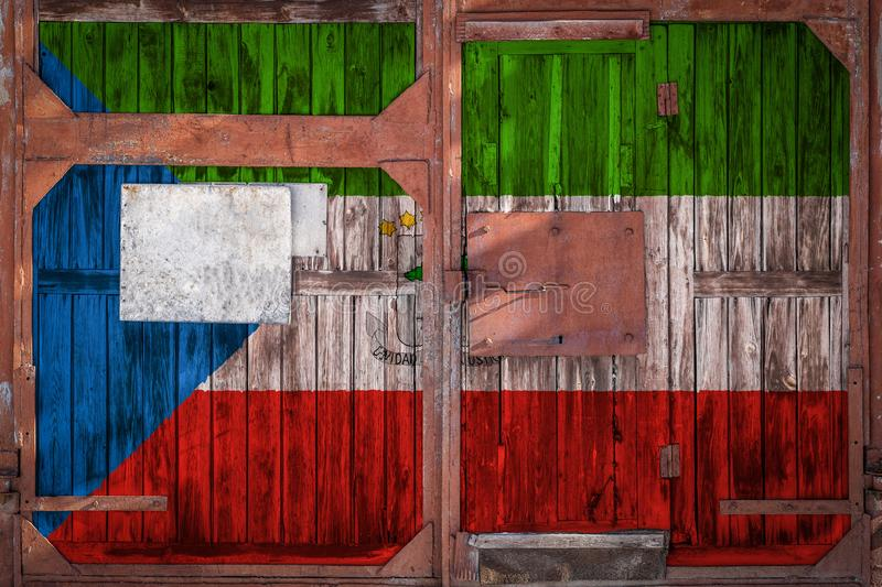 Close-up of old warehouse gate with national flag. Of Equatorial Guinea. The concept of export-import Equotarial Guinea, storage of goods and national delivery vector illustration