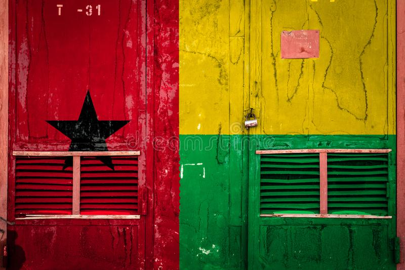 Close-up of old warehouse gate with national flag. Of Guinea bissau .  Concept of Guinea bissau export-import, storage of goods and national delivery of goods stock illustration