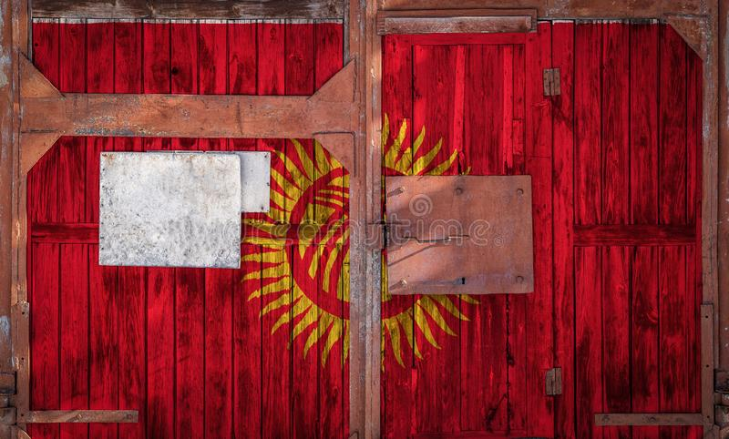 Close-up of old warehouse gate with national flag. Of Kyrgyzstan. The concept of export-import Kyrgyzstan, storage of goods and national delivery of goods. Flag vector illustration