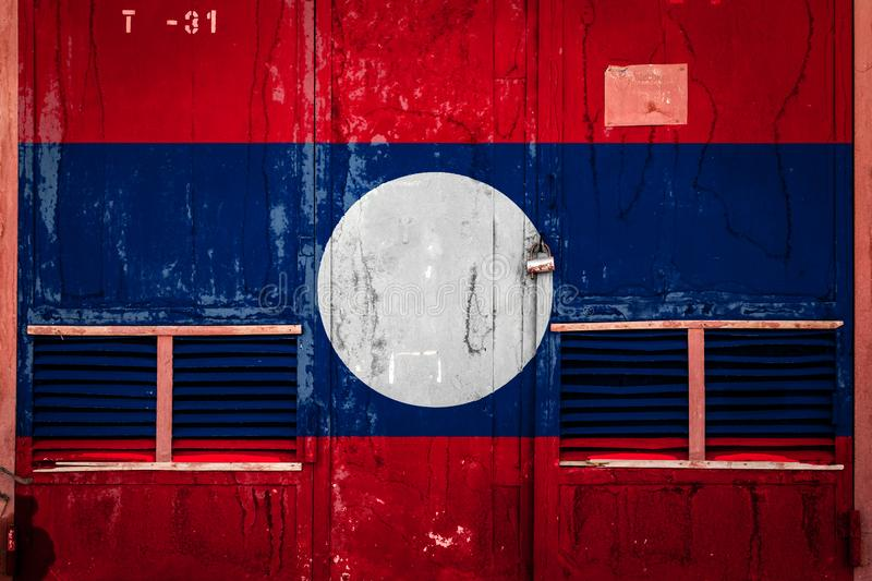 Close-up of old warehouse gate with national flag. Of Laos. Concept of Laos export-import, storage of goods and national delivery of goods. Flag in grunge style royalty free illustration