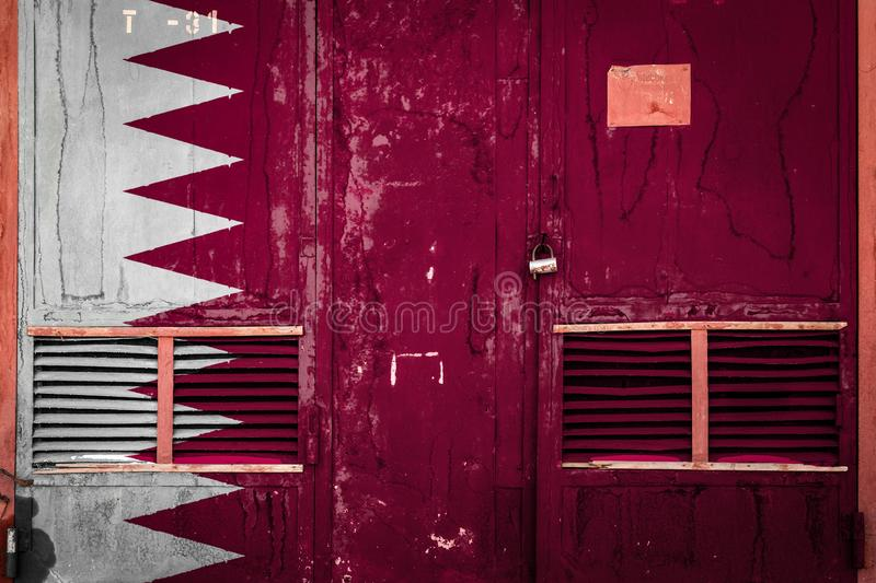 Close-up of old warehouse gate with national flag. Of Qatar. Concept of Qatar export-import, storage of goods and national delivery of goods. Flag in grunge stock illustration