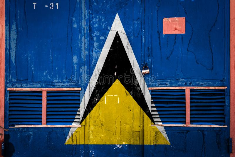 Close-up of old warehouse gate with national flag. Of Saint Lucia. Concept of Saint Lucia export-import, storage of goods and national delivery of goods. Flag vector illustration