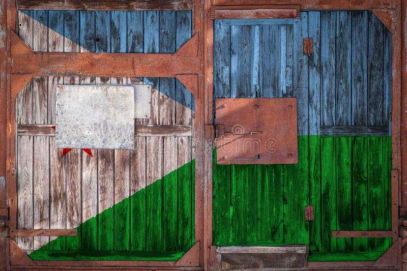 Close-up of old warehouse gate with national flag. Close-up of an old warehouse gate with the national flag of Djibouti. The concept of export-import Djibouti vector illustration