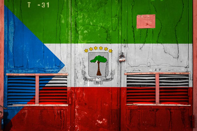 Close-up of old warehouse gate with national flag. Of Equatorial Guinea. The concept of export-import Equotarial Guinea, storage of goods and national delivery stock illustration