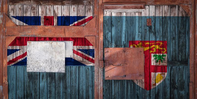 Close-up of old warehouse gate with national flag. Of Fiji. The concept of export-import Fiji, storage of goods and national delivery of goods. Flag in grunge royalty free illustration