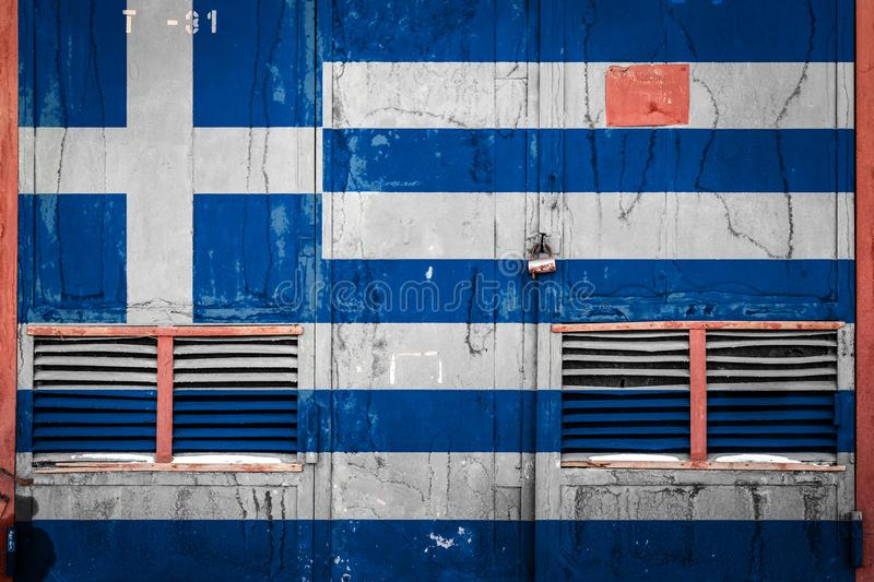 Close-up of old warehouse gate with national flag. Of Greece. Concept of Greece export-import, storage of goods and national delivery of goods. Flag in grunge royalty free illustration