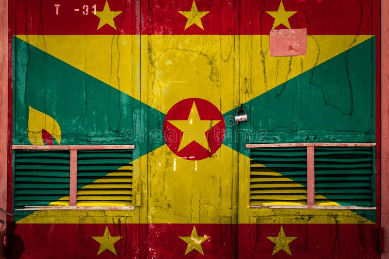 Close-up of old warehouse gate with national flag. Of Grenada. Concept of Grenada export-import, storage of goods and national delivery of goods. Flag in grunge stock illustration