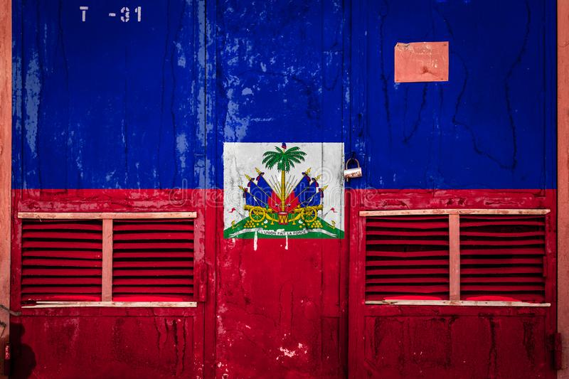 Close-up of old warehouse gate with national flag. Of Haiti. Concept of Haiti export-import, storage of goods and national delivery of goods. Flag in grunge vector illustration