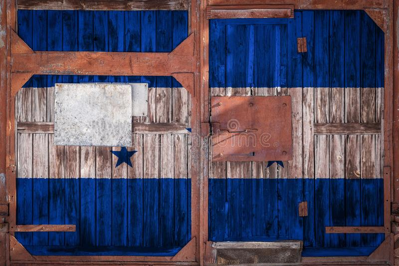 Close-up of old warehouse gate with national flag. Of Honduras. The concept of export-import Honduras, storage of goods and national delivery of goods. Flag in stock illustration