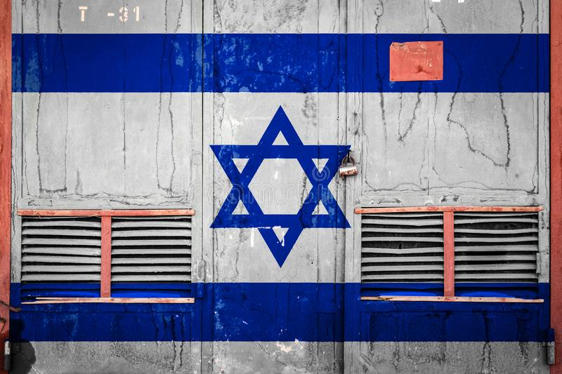 Close-up of old warehouse gate with national flag. Of Israel. Concept of Israel export-import, storage of goods and national delivery of goods. Flag in grunge royalty free illustration