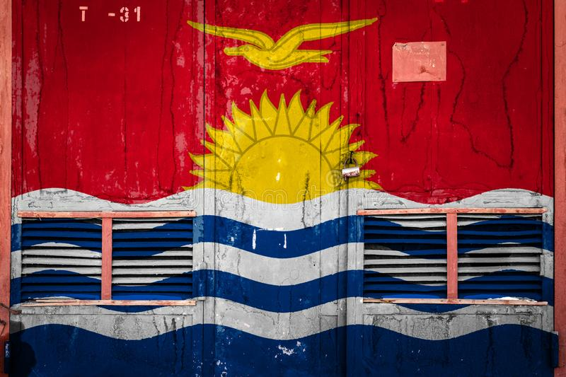 Close-up of old warehouse gate with national flag. Of Kiribati. Concept of Kiribati export-import, storage of goods and national delivery of goods. Flag in royalty free illustration