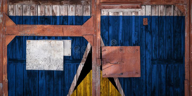 Close-up of old warehouse gate with national flag. Of Saint Lucia. The concept of export-import of Saint Lucia, storage of goods and national delivery of goods royalty free illustration
