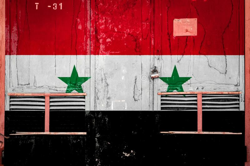 Close-up of old warehouse gate with national flag. Of Syria. Concept of Syria export-import, storage of goods and national delivery of goods. Flag in grunge royalty free illustration