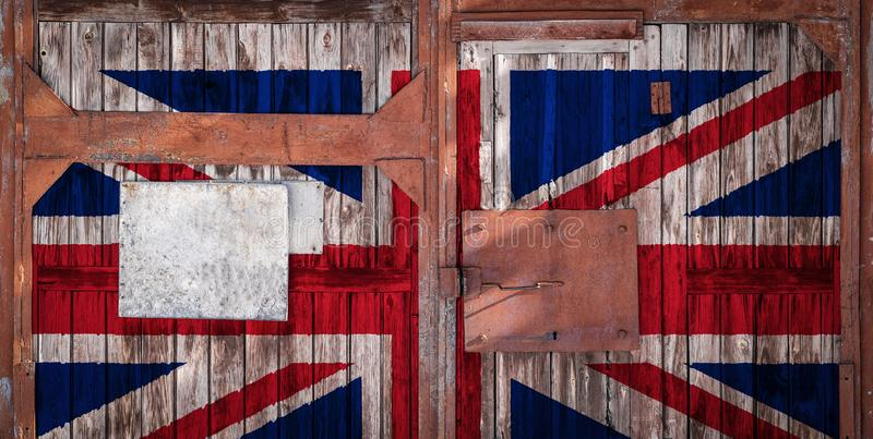 Close-up of old warehouse gate with national flag. Of the United Kingdom. The concept of export-import UK, storage of goods and national delivery of goods. Flag vector illustration