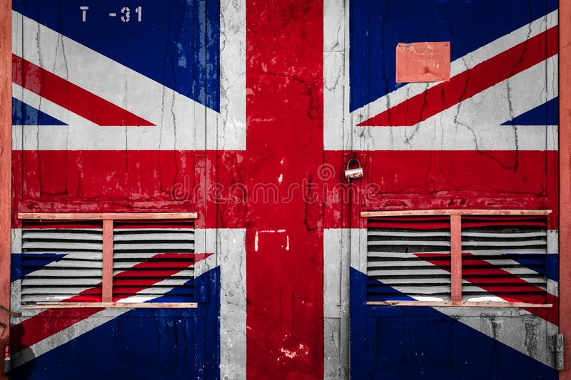Close-up of old warehouse gate with national flag. Of United Kingdom. Concept of United Kingdom export-import, storage of goods and national delivery of goods vector illustration